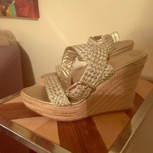 Wedge Espadrille sandals with gold straps.